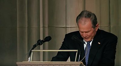 George W. Bush breaks down during eulogy